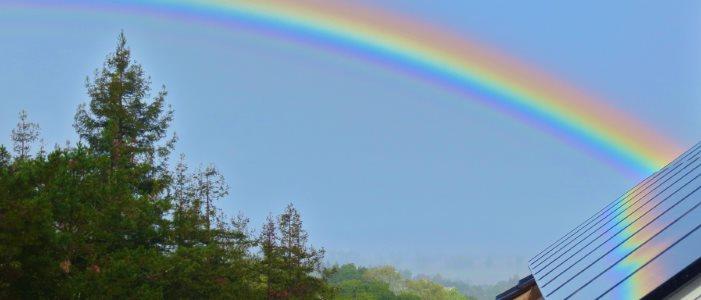 Solar panels and rainbow